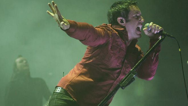 Nine Inch Nails vocalist Trent Reznor performs during a concert at Key Arena in Seattle in 2008.
