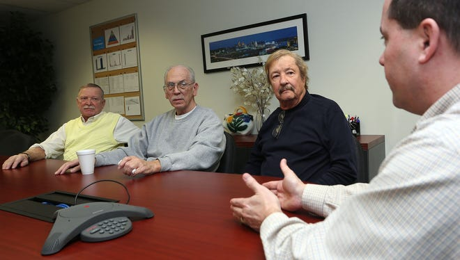 Chuck Eisenhauer, senior Technical Projects Engineer at Supply Dynamics in Cincinnati, meets with retired engineers and now employees Dick Courts, Paul Brumett and Roger Sollberger.