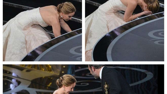 Jennifer Lawrence stumbles on way to collect her best-actress Oscar.