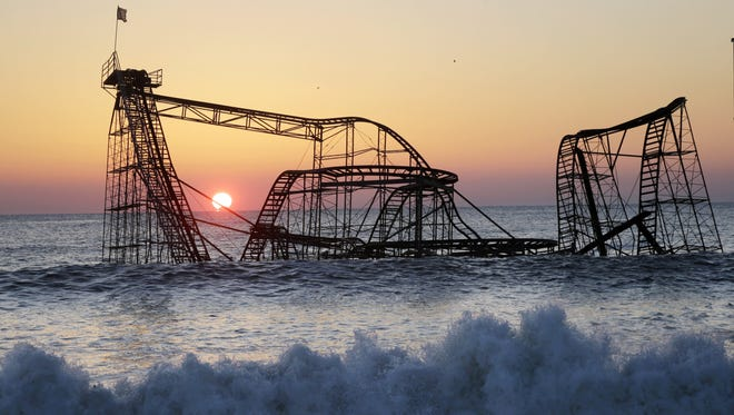 <strong></strong><strong>Seaside Heights, N.J.:</strong> The sun rises Feb. 25 behind the Jet Star Roller Coaster that has been sitting in the ocean after part of Casino Pier was destroyed during Hurricane Sandy.