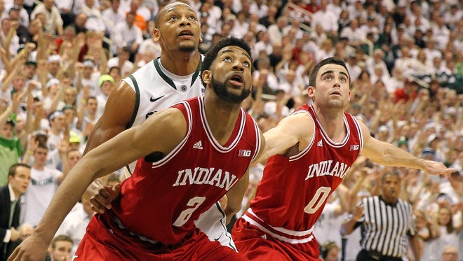 Indiana Hoosiers forwards Christian Watford, left, and Will Sheehey, and Michigan State Spartans center Adreian Payne fight for position during the second half at Jack Breslin Students Events Center.