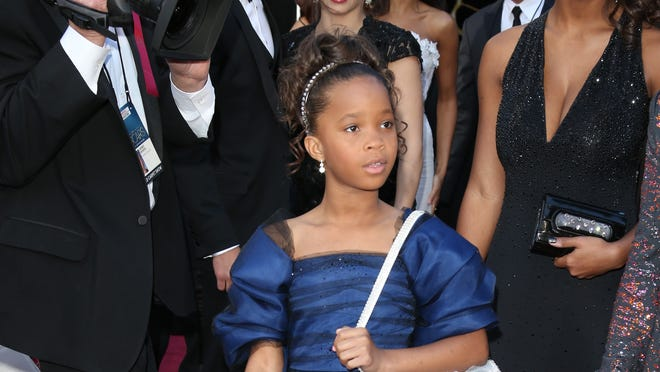 Quvenzhane Wallis arrives on the red carpet at the Academy Awards in Los Angeles.