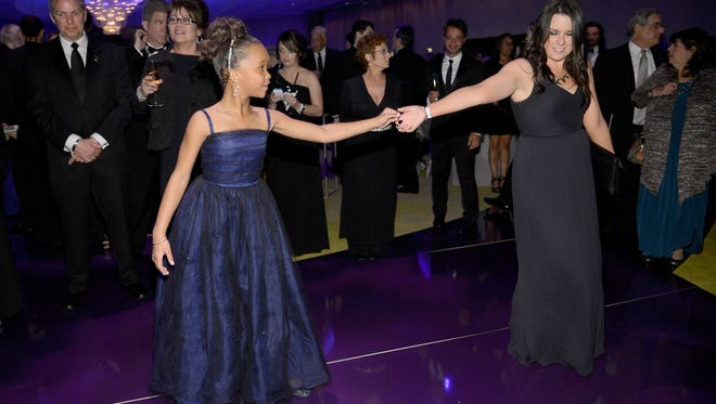 Quvenzhane Wallis dances at the Oscars Governors Ball in Hollywood, Calif.