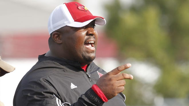 University of Louisville defensive line coach Clint Hurtt, shown during the first day of practice last season, has been charged with unethical conduct by the NCAA for actions allegedly perpetrated while an assistant at Miami.