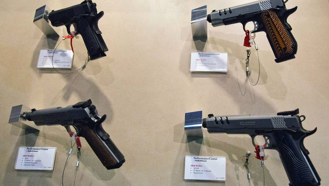 Several of Smith & Wesson new product pistols are displayed at a trade show in Las Vegas.
