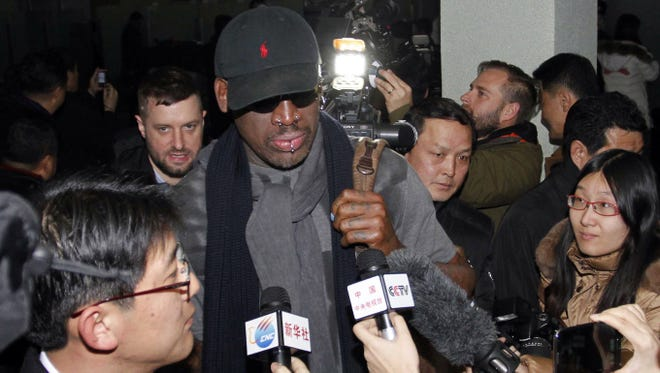 Dennis Rodman is surrounded by journalists upon arrival at Pyongyang Airport, North Korea.