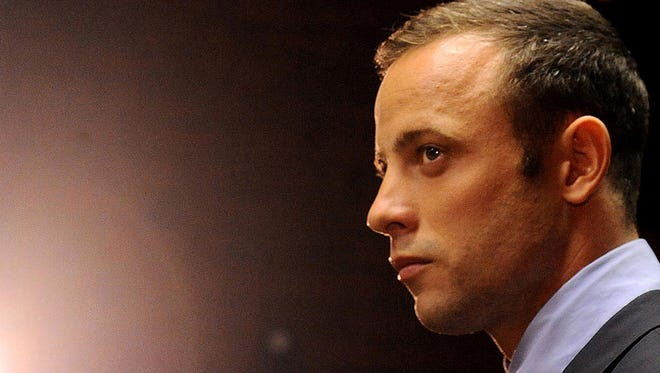 In this photo taken Feb. 22,  Oscar Pistorius appears in court in Pretoria, South Africa, for his bail hearing charged with the shooting death of his girlfriend, Reeva Steenkamp.