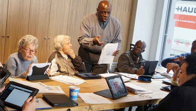 Born Allah teaches an iPad class at the Senior Planet Exploration Center in New York City.