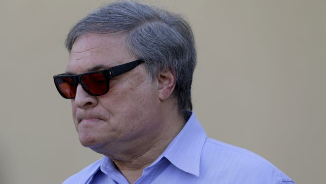 Miami Marlins owner Jeffrey Loria talks during a news conference outside of the team's spring training facility.