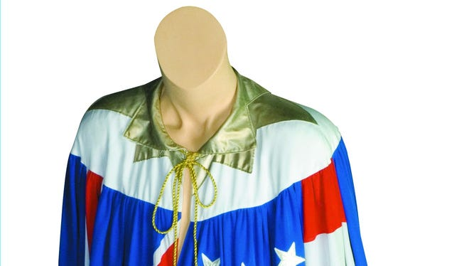 A cape, made from genuine flags, worn by Mick Jagger on the Rolling Stones' 1981-82 U.S. and European tours.