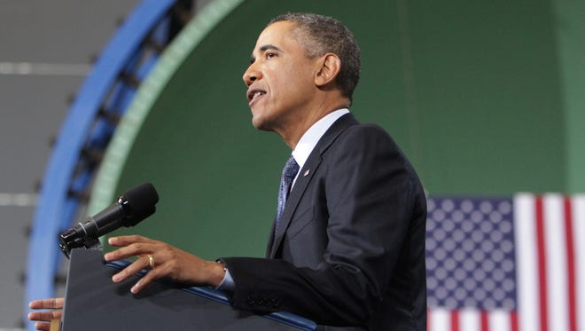 President Obama speaks at Newport News Shipbuilding on Tuesday in his effort to block automatic spending cuts scheduled to begin Friday.