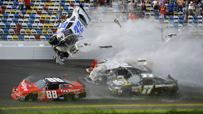 NASCAR Nationwide Series driver Kyle Larson (32) goes up into the fence after being involved in a crash on the final lap during the DRIVE4COPD 300 at Daytona International Speedway.