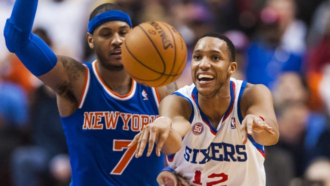 Philadelphia 76ers guard Evan Turner (12) passes the ball as New York Knicks forward Carmelo Anthony (7) defends in a recent game.