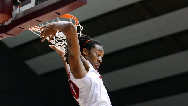 Alabama Crimson Tide guard Levi Randolph comes down after dunking the ball during the second half against the Auburn Tigers at Coleman Coliseum.