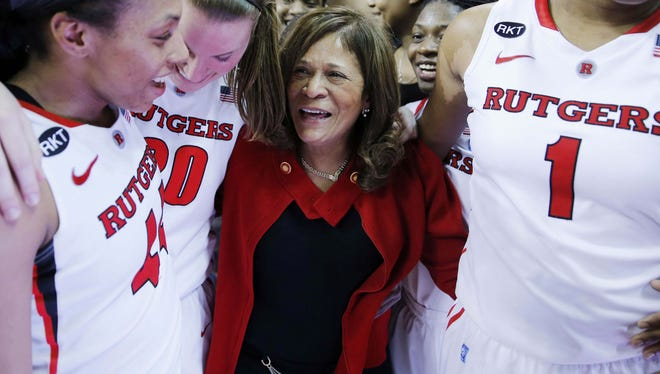 Rutgers Scarlet Knights coach C. Vivian Stringer is congratulated by her team after the game against the South Florida Bulls at Louis Brown Athletic Center. The win was the 900th career coaching victory for Stringer.