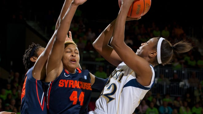Notre Dame Fighting Irish guard Jewel Loyd shoots as Syracuse Orange guard Carmen Tyson-Thomas defends in the second half at the Purcell Pavilion.