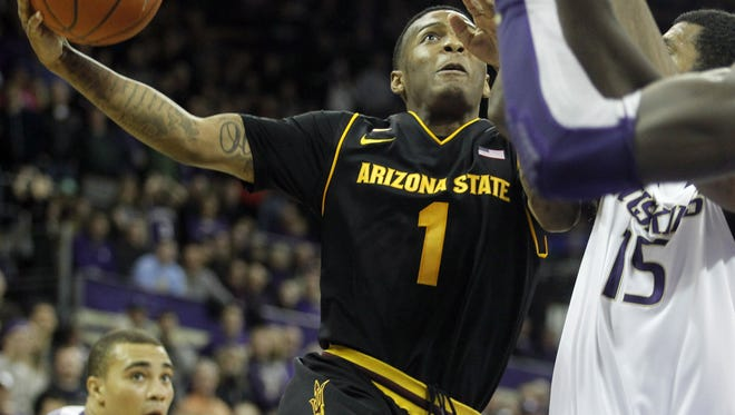 Arizona State guard Jahii Carson (1) drives to the basket in a game against the Washington Huskies earlier this season.