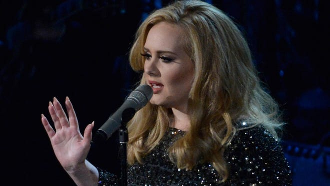 Adele sings the theme from 'Skyfall' at the 2013 Academy Awards.