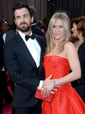 Justin Theroux and Jennifer Aniston arrive at the Oscars at Hollywood & Highland Center on Feb.24.