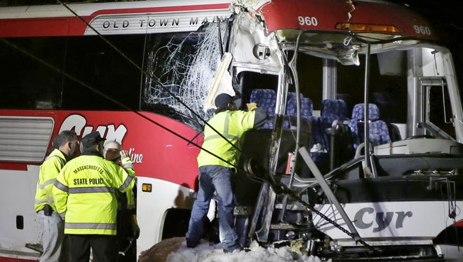 The bus was carrying University of Maine basketball players and crashed into trees on the side of Interstate 95, north of Boston, injuring the driver and several students.