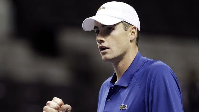 Top-seeded John Isner got past feisty Jesse Levine 7-6 (3), 5-7, 6-4 to advance to the second round of the Delray Beach International Tennis Championships on Tuesday.