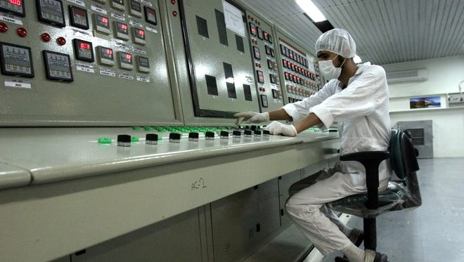 An Iranian technician works at a uranium conversion facility south of the capital city of Tehran.