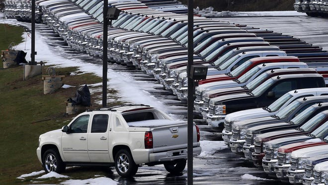In this Wednesday, Jan. 9, 2013 photo, Chevy trucks line the lot of a dealer in Murrysville, Pa.