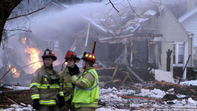 Firefighters respond Feb. 27 to a house explosion in the Detroit suburb of Royal Oak, Mich. One man died.