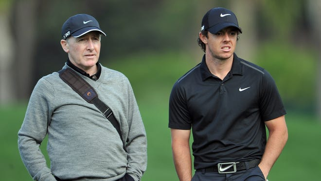 Rory McIlroy of Northern Ireland talks with his coach Michael Bannon during the Honda Classic pro-am on Wednesday.