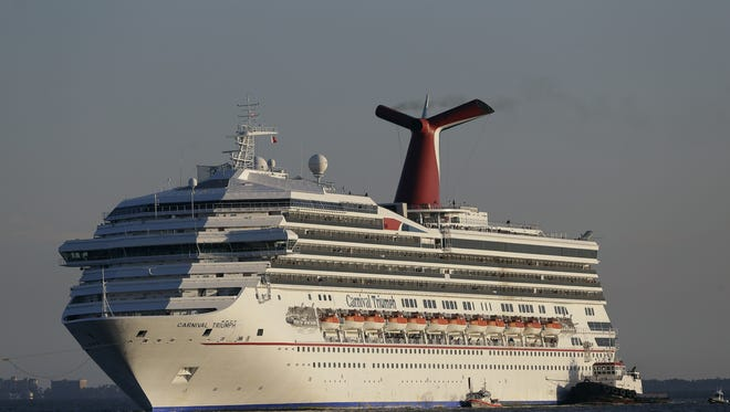 The Carnival Triumph is towed into Mobile Bay near Dauphin Island, Ala., on Valentine's Day.