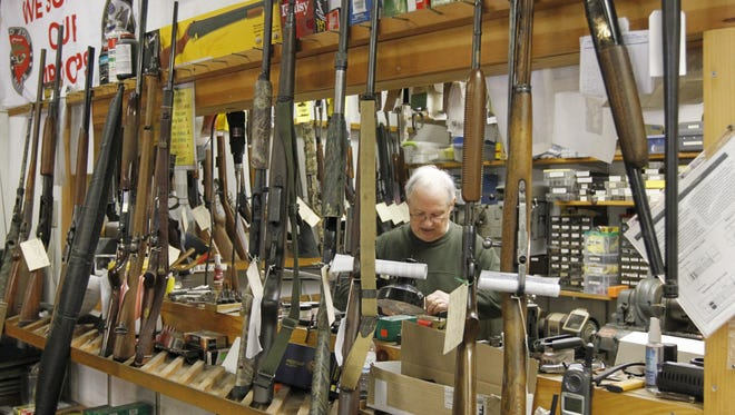Paul Martin, owner operator of Pro-Gun Services in Victor, N.Y., works in his shop in the back of his store on Friday, Feb. 22, 2013.