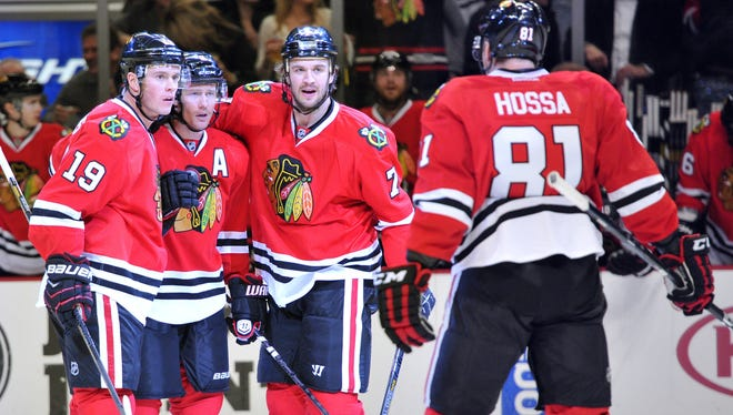 From left to right, Chicago Blackhawks center Jonathan Toews, defenseman Duncan Keith, defenseman Brent Seabrook and right wing Marian Hossa celebrate a goal against the St. Louis Blues at the United Center.