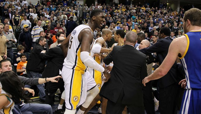 Indiana Pacers center Roy Hibbert (55) yells at Golden State Warriors center David Lee (10) as a fight breaks out during the game at Bankers Life Fieldhouse. Indiana defeats Golden State 108-97. Mandatory Credit: Brian Spurlock-USA TODAY Sports  ORG XMIT: USATSI-96656 ORIG FILE ID:  20130226_jla_ss1_297.jpg