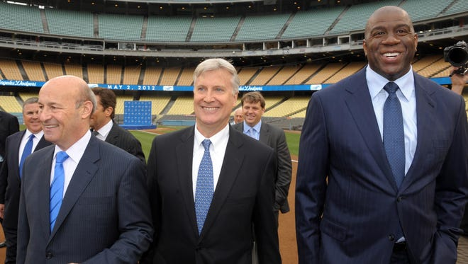 Stan Kasten and Mark Walter arrive at press conference to announce their purchase of the Los Angeles Dodgers at Dodger Stadium in Mary.