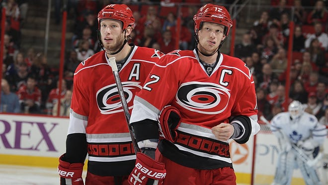Eric Staal (right) and his younger brother, Jordan Staal, have been immensely important for Carolina this season. The brothers have a combined 34 points through 18 games.