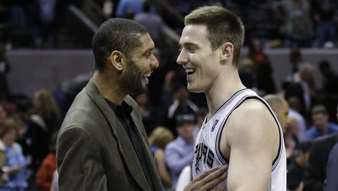 San Antonio Spurs' Tim Duncan, left, talks to Aron Baynes, right, after a recent game. Baynes was recalled from the NBDL on Thursday.