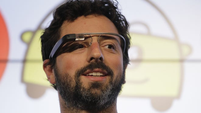 Google co-founder Sergey Brin stands on stage during a bill-signing by California Gov. Edmund Brown for driverless cars at Google headquarters in Mountain View, Calif., Sept. 25, 2012.
