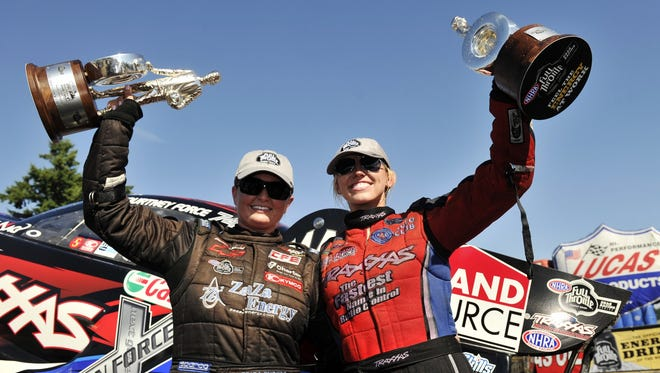 Erica Enders-Stevens, left, and Courtney Force celebrate their victories at the O'Reilly Auto Parts NHRA Northwest Nationals in Kent, Wash., on Aug. 5, 2012.