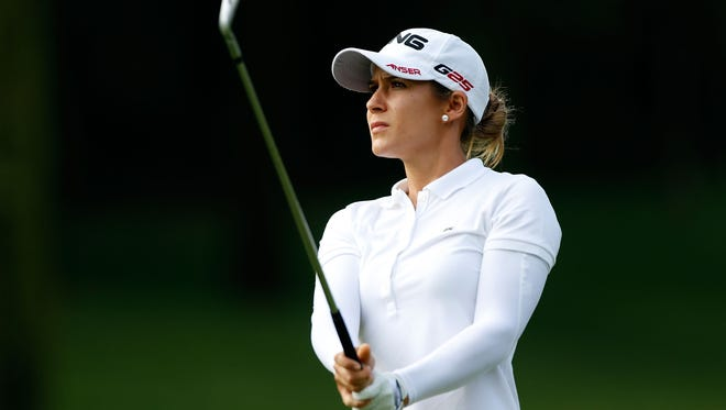 Azahara Munoz of Spain watches her approach shot on the first hole during the first round of the HSBC Women's Champions.