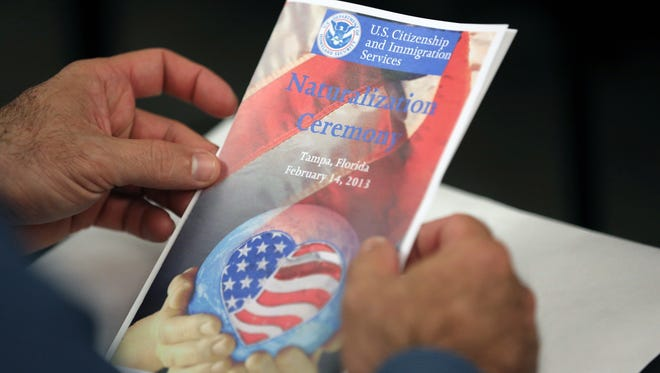 A program at a naturalization ceremony in Tampa this month.