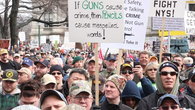 Gun-rights advocates demonstrate Feb. 28 outside the state Capitol in Albany, N.Y. It is one in a series of rallies that opponents of recently enacted state gun-control laws have organized.