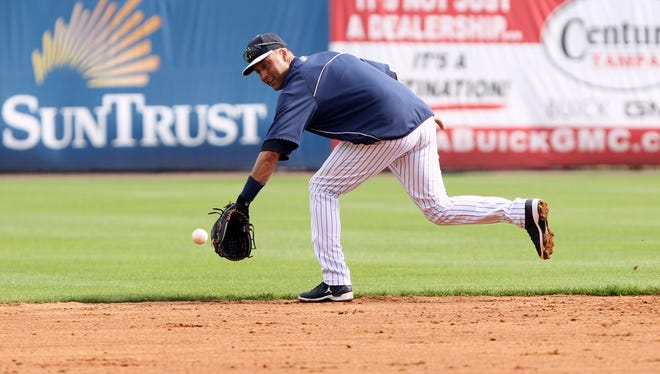 Yankees shortstop Derek Jeter, shown Sunday, had surgery for a broken ankle suffered during the playoffs in October, and his status for opening day is uncertain.