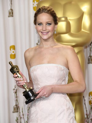 Jennifer Lawrence  poses in the photo room at the 85th annual Academy Awards.