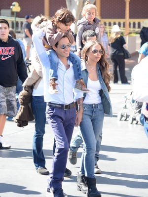 Marc Anthony takes twins Max and Emme and girlfriend Chloe Green to Disneyland on Tuesday.