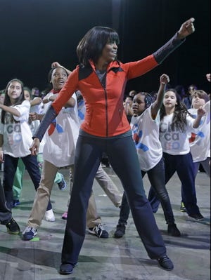 First lady Michelle Obama exercises with Chicago kids to promote more PE in schools.