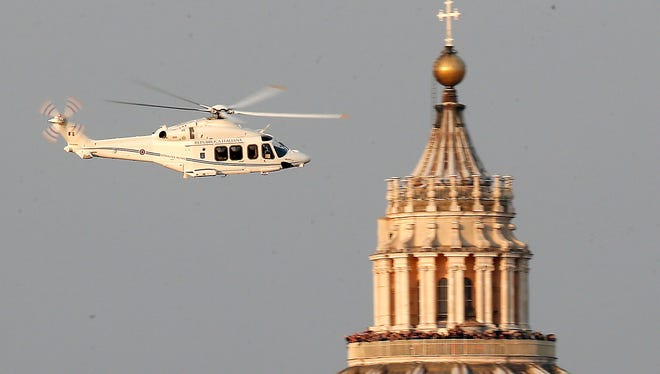 A helicopter with Pope Benedict XVI onboard leaves the Vatican in Rome on Feb. 28.