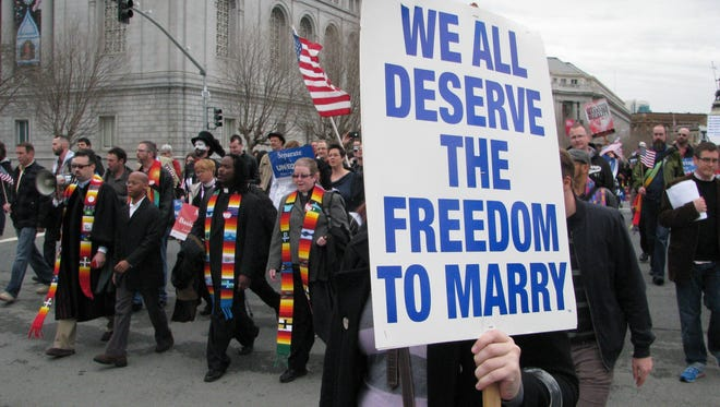 Marchers in San Francisco celebrate a court ruling striking down Proposition 8 on Feb. 7, 2012.