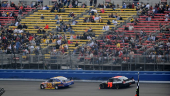 Fans dot the stands during the Sprint Cup race at Auto Club Speedway in 2009.