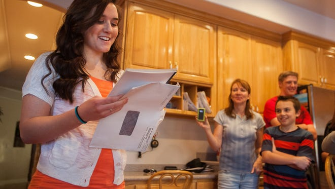 Surrounded by family and friends, Melissa Empey opens her LDS mission call at her home in St. George, Utah, on Thursday, Feb. 7, 2013.
