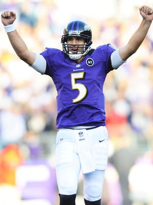 Baltimore Ravens quarterback Joe Flacco (5) celebrates after throwing a touchdown pass in the third quarter against the Oakland Raiders at M&T Bank Stadium.